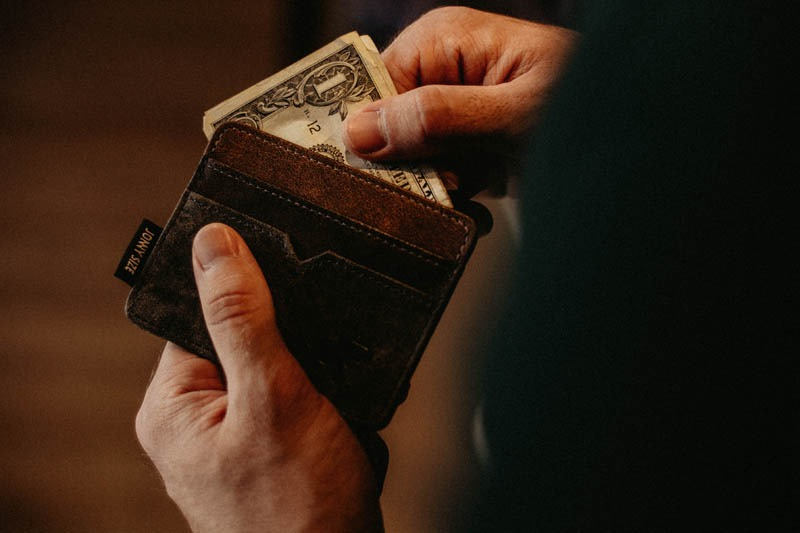 Man pulling bills out of a wallet