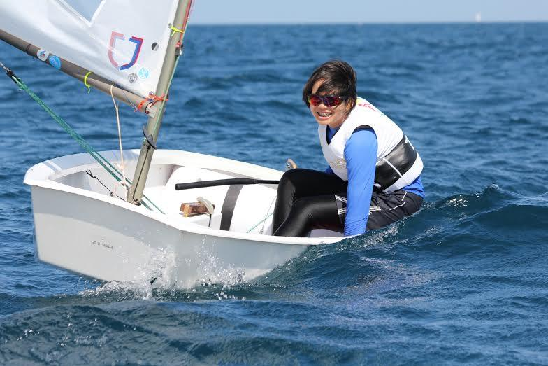 young woman sailing a topper