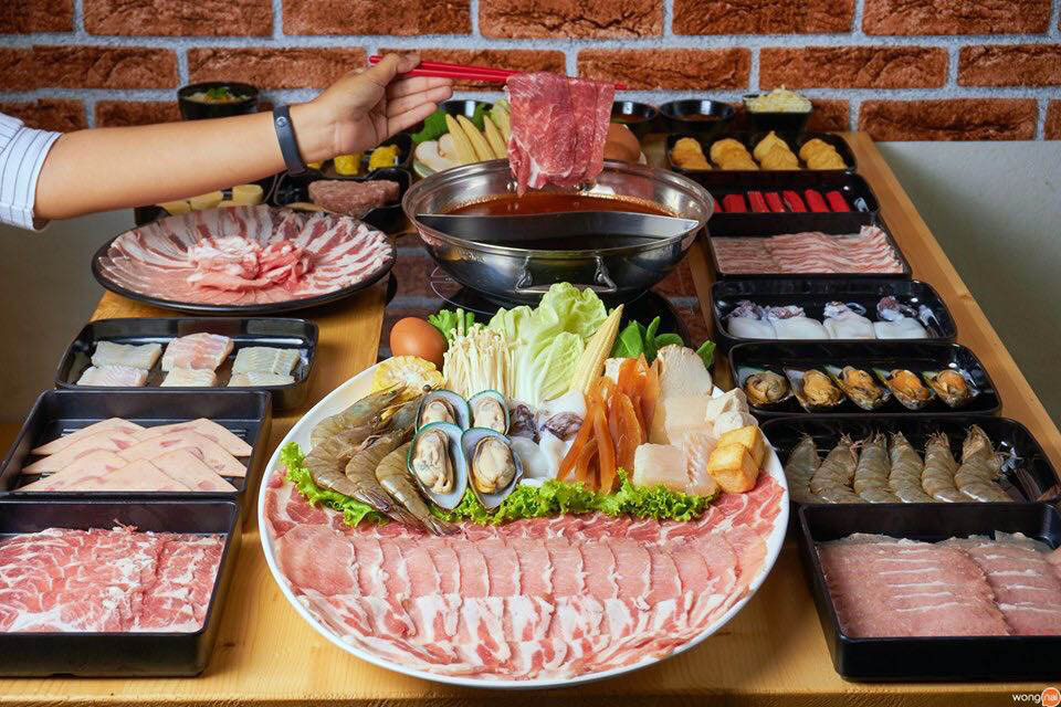 Platter with meats, seafood, and vegetables