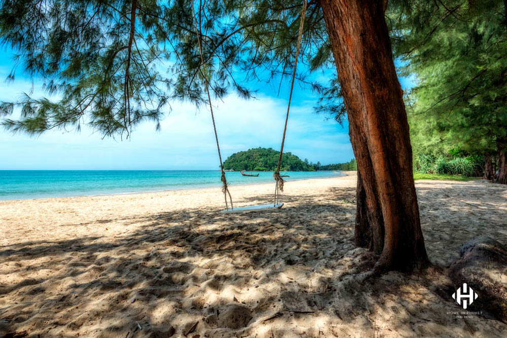 Rope swing on Layan Beach