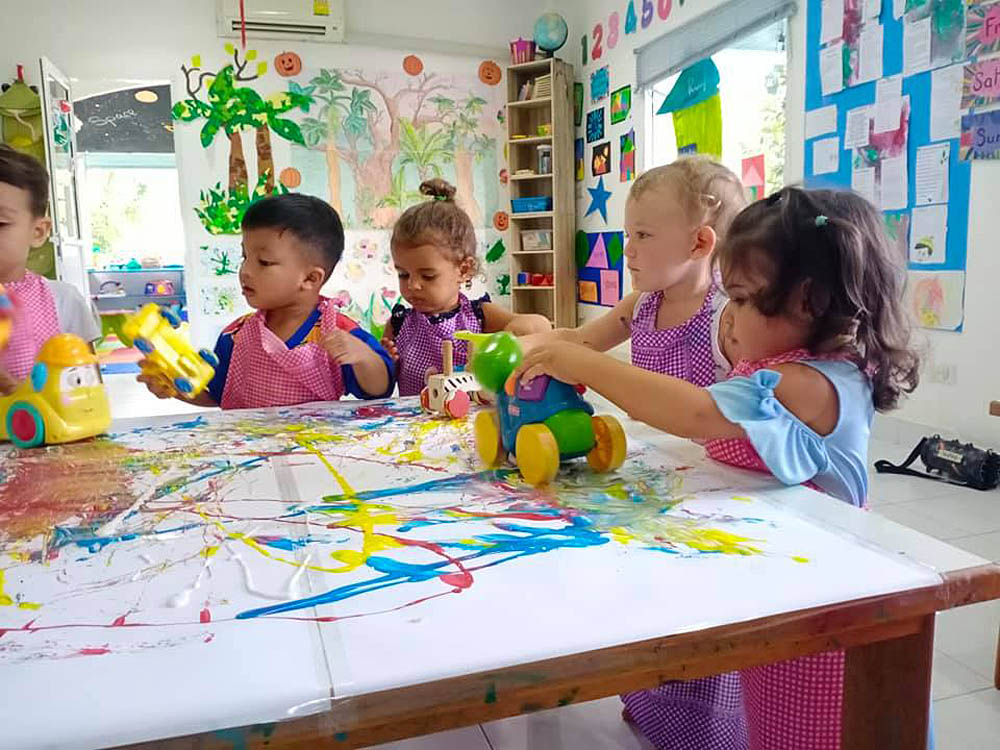 Kids playing with toys in a classroom