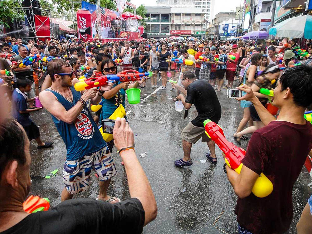 Tourists and locals enjoying a water fight