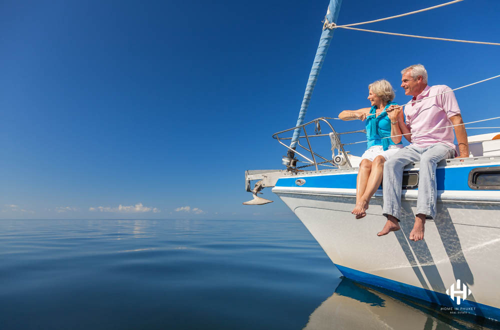 Older couple enjoying a gentle cruise on a yacht